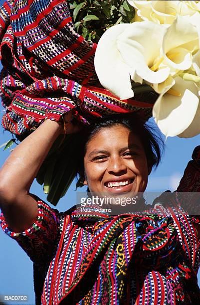 woman carrying plants on her head, portrait - guatemala fotografías e imágenes de stock