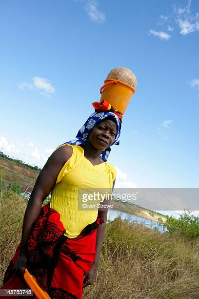 woman carrying pumpkin, nampula province. - nampula province stock pictures, royalty-free photos & images