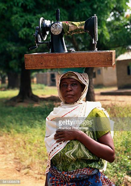 Woman Carrying Sewing Machine on Head