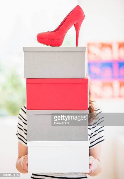 Woman carrying shoes boxes