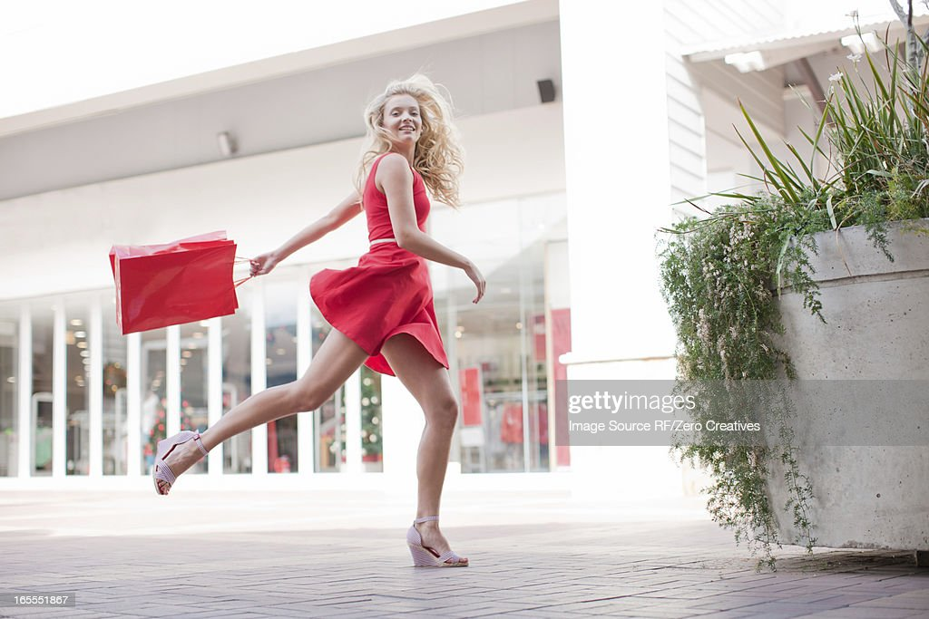 Woman carrying shopping bag outdoors : Stock Photo