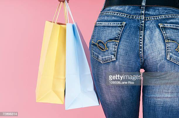 Woman carrying shopping bags, close-up