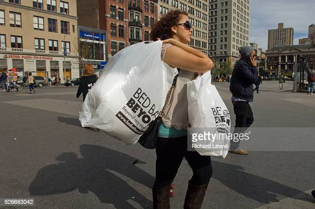 Woman carrying shopping bags from Bed Bath and Beyond walks through Union Square in New York on Thursday, October 8, 2009. The retail chain announced...