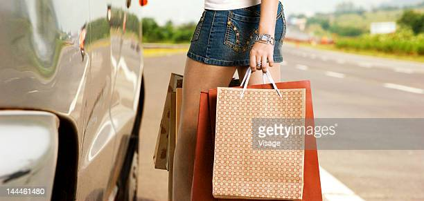 woman carrying shopping bags - short skirts in cars stock photos and pictures