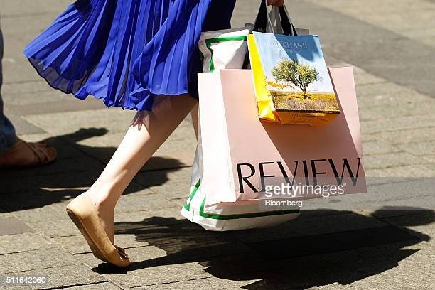 A woman carrying shopping bags walks outside the Westfield Sydney shopping center operated by Scentre Group in Sydney Australia on Friday Feb 19 2016...
