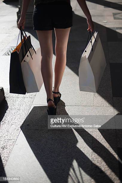 Woman carrying shopping on city street