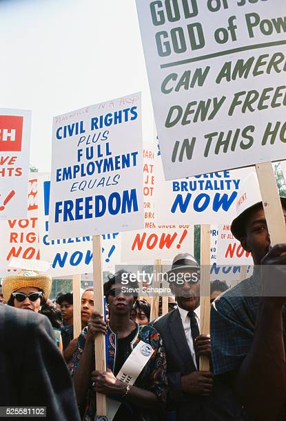 Woman carrying sign reading 'Civil Rights Plus Full Employment Equals Freedom' More than 200000 people participated in the March on Washington...