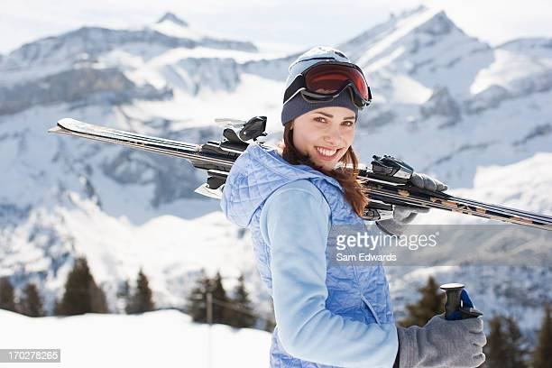 woman carrying skis - female skier stock pictures, royalty-free photos & images