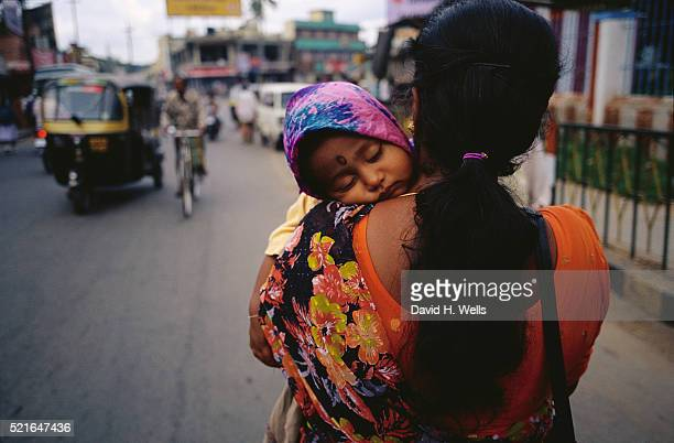 Woman Carrying Sleeping Child