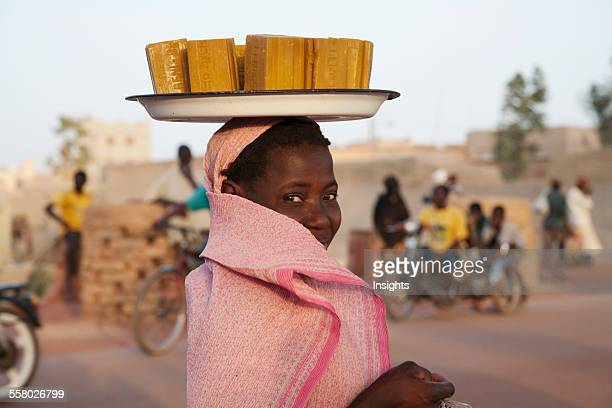Woman carrying soap bars of her head in Mopti Mali
