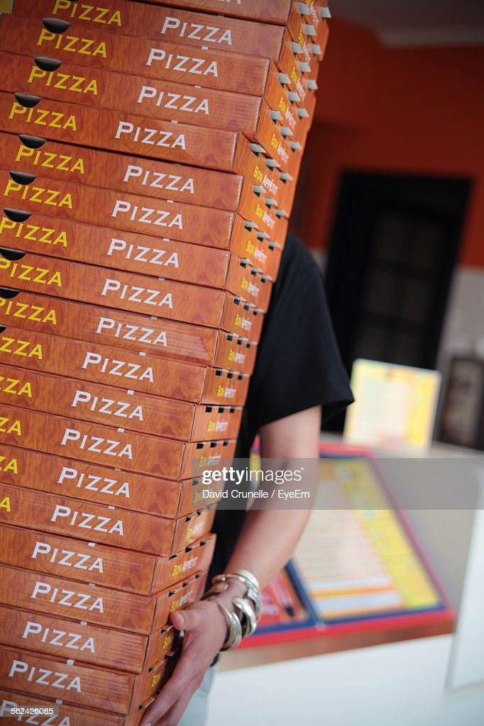 Woman Carrying Stack Of Pizza Boxes : Stock Photo