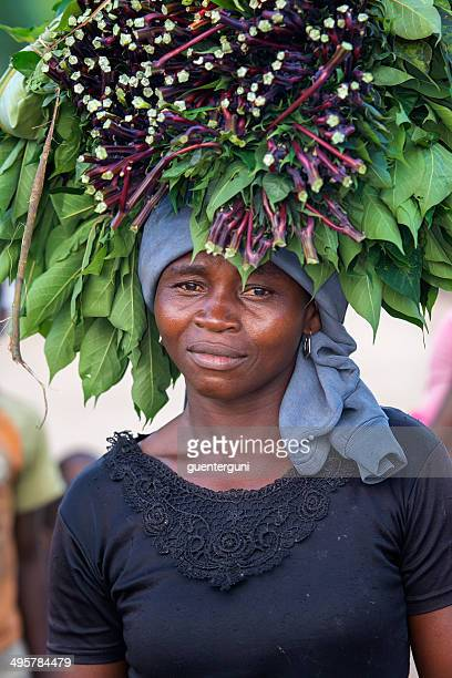 Woman carrying vegetables on her head
