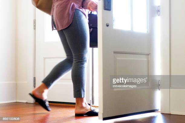woman carrying walking out from door. - leaving stock pictures, royalty-free photos & images