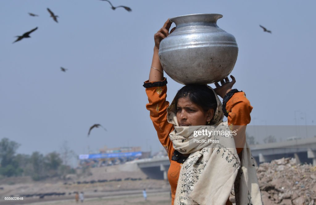 A woman carrying water ahead of International World Water Day International World Water Day is held annually on March 22 to focus global attention on.