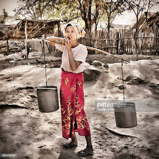 CONTENT] Woman carrying water buckets in Swhesidaing village