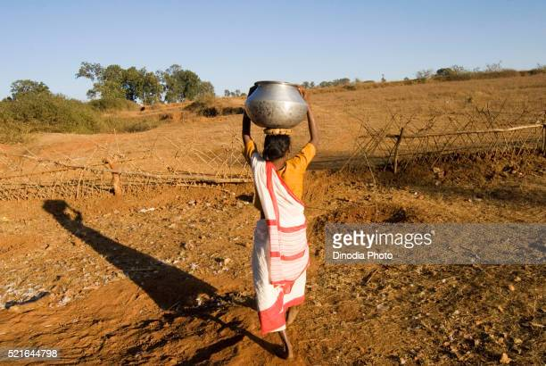 woman carrying water in ranchi jharkhand india asia - scarce stock pictures, royalty-free photos & images