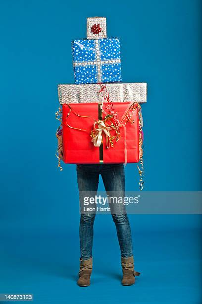 Woman carrying wrapped gifts