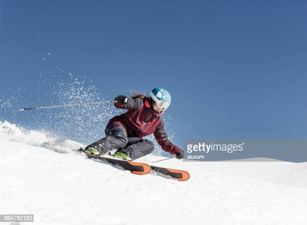 Woman carving skiing
