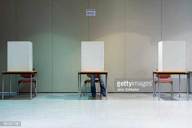 A woman cast her ballots in the German federal elections at a culture center on September 22 2013 in Halle Germany Germany is holding federal...