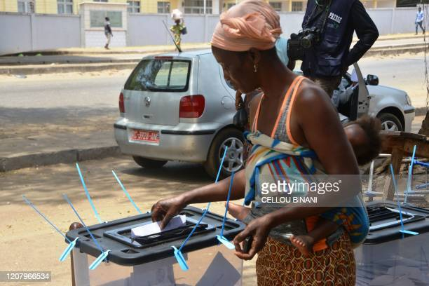 A woman cast her vote at a polling station in Conakry on March 22 during a constitutional referendum in the country Guinean President Alpha Condé...