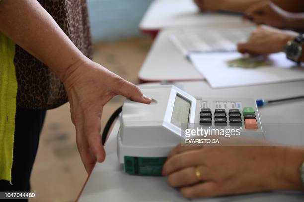 A woman cast her vote during the Brazilian general elections in Brasilia on October 7 2018 Polling stations opened in Brazil on Sunday for the most...