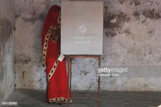 A woman casting her vote at a polling booth on February 11 2017 in Noida India Uttar Pradesh registered a voter turnout of 63% in the first phase of...