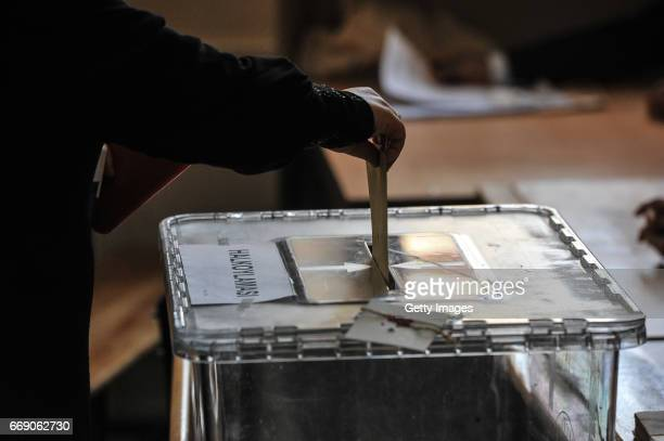 A woman casts her ballot at a polling station during a referendum in Istanbul April 16 2017 Turkey Millions of Turks are heading to the polls to vote...