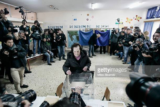 A woman casts her ballot at a polling station in a school in a suburb of Athens on January 25 2015 near Athens Greece According to the latest opinion...