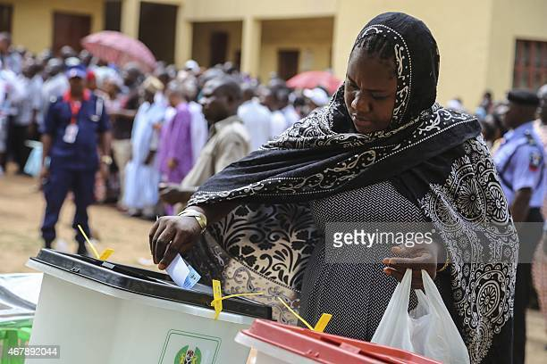 A woman casts her ballot at a polling station in Abuja on March 28 2015 during presidential elections Voting began in Nigeria's general election but...