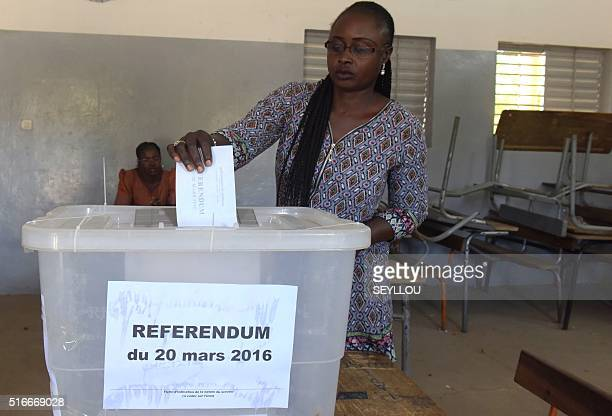 A woman casts her ballot at a polling station in Fatick on March 20 2016 as part of a referendum on sweeping constitutional reforms including cutting...