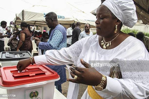 A woman casts her ballot at a polling station in Lagos during presidential elections on March 29 2015 Nigeria's closely fought general election went...