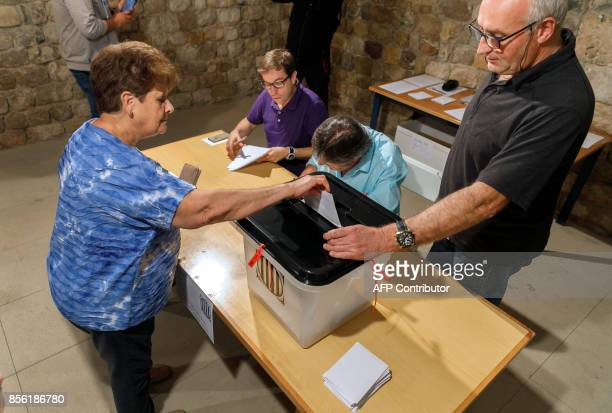 A woman casts her ballot at a polling station in Llado on October 01 during a referendum on independence for Catalonia banned by Madrid More than 53...