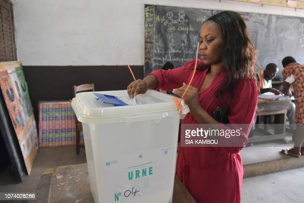 A woman casts her ballot at a polling station in Port Bouet during the local elections on December 16 2018 in Abidjan Six locals and two regionals...