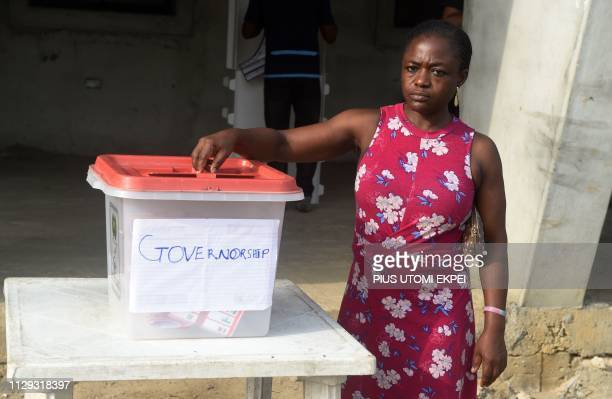 A woman casts her ballot at a polling station in Port Harcourt Rivers State on March 9 during voting to elect governors and lawmakers in 29 of the...