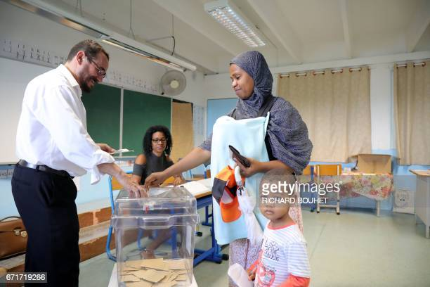 A woman casts her ballot at a polling station in SaintDenis de la Reunion on the French Indian Ocean island of La Reunion on April 23 during the...