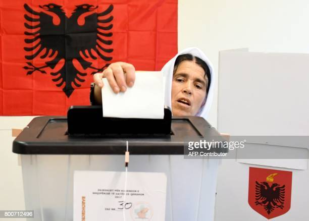 A woman casts her ballot at a polling station in Tirana during a parliamentary election on June 25 2017 Albania votes in a parliamentary election...