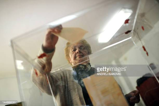 Woman casts her ballot at a polling station on May 20 in Belgrade. Serbians vote for a new president in a run-off with the incumbent Boris Tadic who...