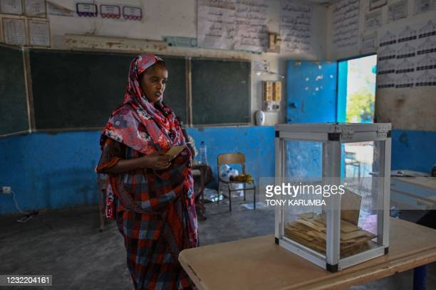 Woman casts her ballot at the Ambouli-II A polling centre in the capital Djibouti on April 9, 2021. - Djibouti's veteran ruler Ismail Omar Guelleh...
