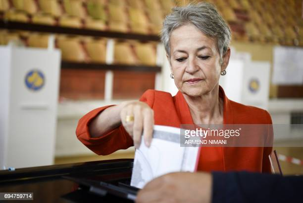 A woman casts her ballot at the polling station in Pristina on June 11 2017 during early parliamentary elections in Kosovo Kosovo began voting for a...