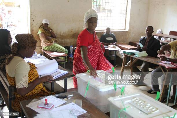 A woman casts her ballot during a partial rerun of the presidential elections on May 11 2016 in Mramani on Anjouan Island Several thousand voters in...