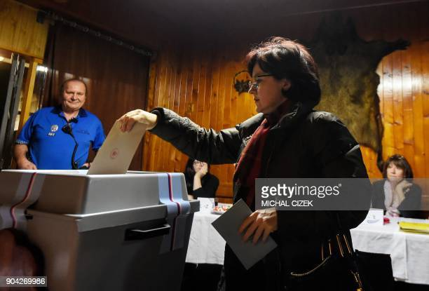 A woman casts her ballot during the first round of the presidential election at a polling station on January 12 2018 in Prague The first round of the...