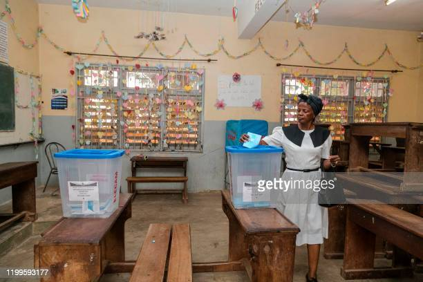 Woman casts her ballot during the general and municipal elections in Yaounde on February 9, 2020.