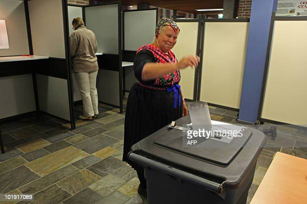 A woman casts her ballot for the parlimentary Dutch elections in Staphorston on July 9 2010 Dutch voters cast ballots today for a new parliament with...