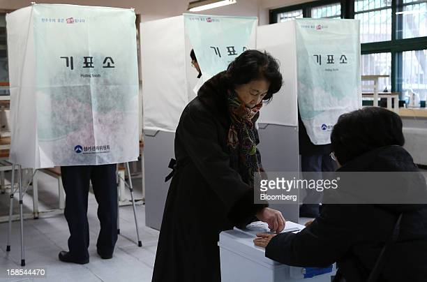A woman casts her ballot for the presidential election at a polling station in Seoul South Korea on Wednesday Dec 19 2012 South Koreans go to the...