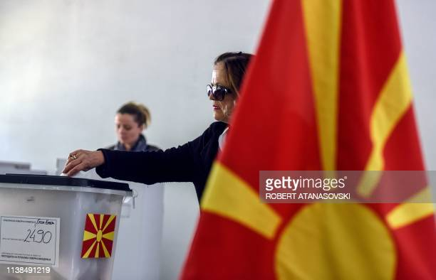 Woman casts her ballot for the presidential elections at a polling station in Skopje on April 21, 2019. - North Macedonians voted for a new president...