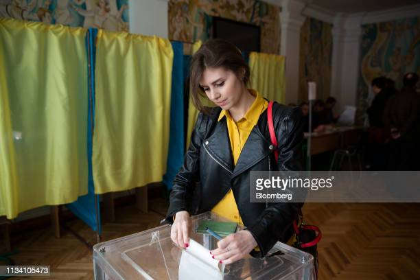 A woman casts her ballot in a ballot box at a polling station in Kiev Ukraine on Sunday March 31 2019 Ukrainians will choose between a field of...