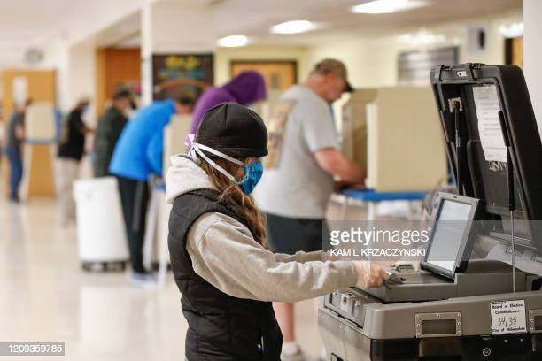 Woman casts her ballot in a Democratic presidential primary election at the Hamilton High School in Milwaukee, Wisconsin, on April 7, 2020. -...