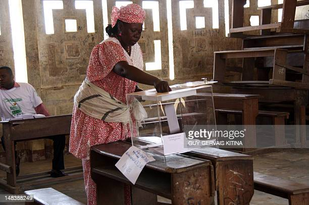 A woman casts her ballot in a polling station for the parliamentary elections in Brazzaville on July 15 2012 More than two million voters are called...
