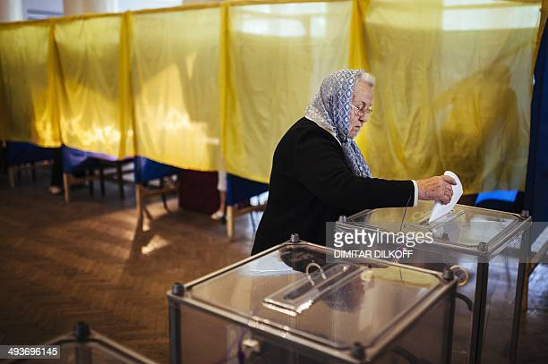 A woman casts her ballot in a polling station in the eastern Ukrainian town of Dobropillya on May 25 2014 Ukraine was voting May 25 in a presidential...
