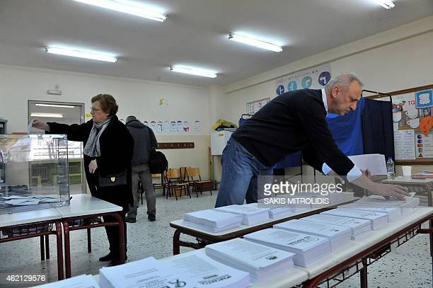 A woman casts her ballot in a polling station in Thessaloniki on January 2015 Greece votes today in a crucial general election that could bring the...